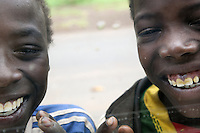 Ethiopia. Southern Nations, Nationalities, and Peoples' Region. Karat village. Konso tribe. Two Konso boys laughing through a car window. The Konso, also known as the Konzo, are a Cushitic-speaking ethnic group. They are agriculturists. Although the Konso people have many customs dating back hundreds of years, it is not uncommon for them to be seen wearing western clothing. The Omo Valley, situated in Africa's Great Rift Valley, is home to an estimated 250,000 individuals of the Konso tribe. Southern Nations, Nationalities, and Peoples' Region (often abbreviated as SNNPR) is one of the nine ethnic divisions of Ethiopia 7.11.15 © 2015 Didier Ruef