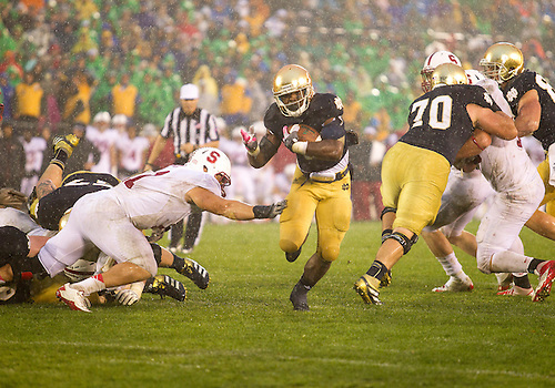 October 13, 2012:  Notre Dame running back Theo Riddick (6) runs through the line of scrimmage during NCAA Football game action between the Notre Dame Fighting Irish and the Stanford Cardinal at Notre Dame Stadium in South Bend, Indiana.  Notre Dame defeated Stanford 20-13.