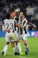 Calcio, Serie A: Juventus vs Milan. Torino, Juventus Stadium, 10 marzo 2017.<br /> Juventus&rsquo; Paulo Dybala, second from left, celebrates with his teammates Dani Alves, left, Moise Kean, second from right and Miralem Pjanic, after scoring on a penalty kick the winning goal during the Italian Serie A football match between Juventus and AC Milan at Turin's Juventus Stadium, 10 March 2017. Juventus won 2-1.<br /> UPDATE IMAGES PRESS/Manuela Viganti