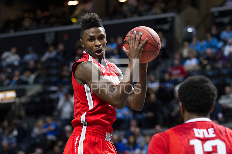 BROOKLYN, NY - Saturday December 19, 2015: Kam Williams (#15) of Ohio State grabs a rebound against the Kentucky Wildcats as the two teams square off in the CBS Classic at Barclays Center in Brooklyn, NY.