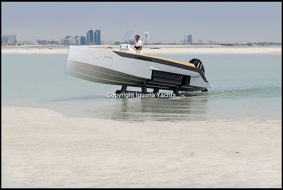 BNPS.co.uk (01202 558833)<br /> Pic: IguanaYachts/BNPS<br /> <br /> The world's first amphibious boat to feature tank-style caterpillar tracks that allow it to be driven out of the water and onto land has been launched.<br /> <br /> The state-of-the-art speedboat can travel at speeds of 40mph on the water - then at a touch of a button the tracks can be deployed so it can be driven onto the land.<br /> <br /> The makers of the luxury vessel, called the Iguana 29, claim it can handle a range of terrains from sand to mud and can go at 4.5mph when ashore. <br /> <br /> The revolutionary design banishes the need for a trailer, but boat owners will have to dig deep for the privilege - prices start at £200,000 and go up to £300,000 for the top spec model.