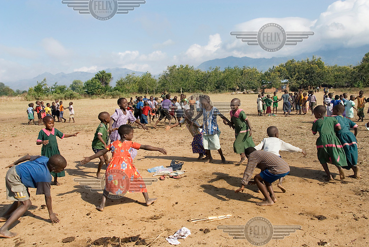 Standard 1 pupils play in the school field at breaktime at Mchere primary school.