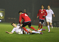 Albion Avdijaj falls under the challenge from Aram Shakhnazaryan in the Armenia v Switzerland UEFA European Under-19 Championship Qualifying Round match at New Douglas Park, Hamilton on 11.10.12.