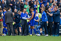 Cardiff City owner Vicent Tan congratulates Lee Peltier at full time of the Sky Bet Championship match between Cardiff City and Aston Villa at the Cardiff City Stadium, Cardiff, Wales on 12 August 2017. Photo by Mark  Hawkins / PRiME Media Images.