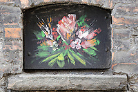 Artwork on a stone wall in in King's Lane off High Street, Swansea, Wales, UK. Thursday 16 August 2018