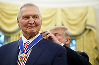 President Donald Trump presents the Presidential Medal of Freedom to NBA Hall of Fame member Jerry W