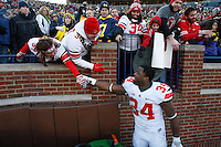 Ohio State Buckeyes running back Carlos Hyde (34) celebrates with fans after the college football game between the Ohio State Buckeyes and the Michigan Wolverines at Michigan Stadium in Ann Arbor, Michigan Saturday afternoon, November 30, 2013. The Ohio State Buckeyes defeated the Michigan Wolverines 42 - 41. (The Columbus Dispatch / Eamon Queeney)