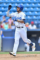 Asheville Tourists Niko Decolati (19) runs home after hitting a home run during a game against the Columbia Fireflies at McCormick Field on June 23, 2019 in Asheville, North Carolina. The Fireflies defeated the Tourists 11-9. (Tony Farlow/Four Seam Images)
