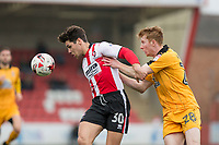 Dan Holman of Cheltenham Town shields the ball from Brad Halliday of Cambridge United during the Sky Bet League 2 match between Cheltenham Town and Cambridge United at the LCI Stadium, Cheltenham, England on 18 March 2017. Photo by Mark  Hawkins / PRiME Media Images.
