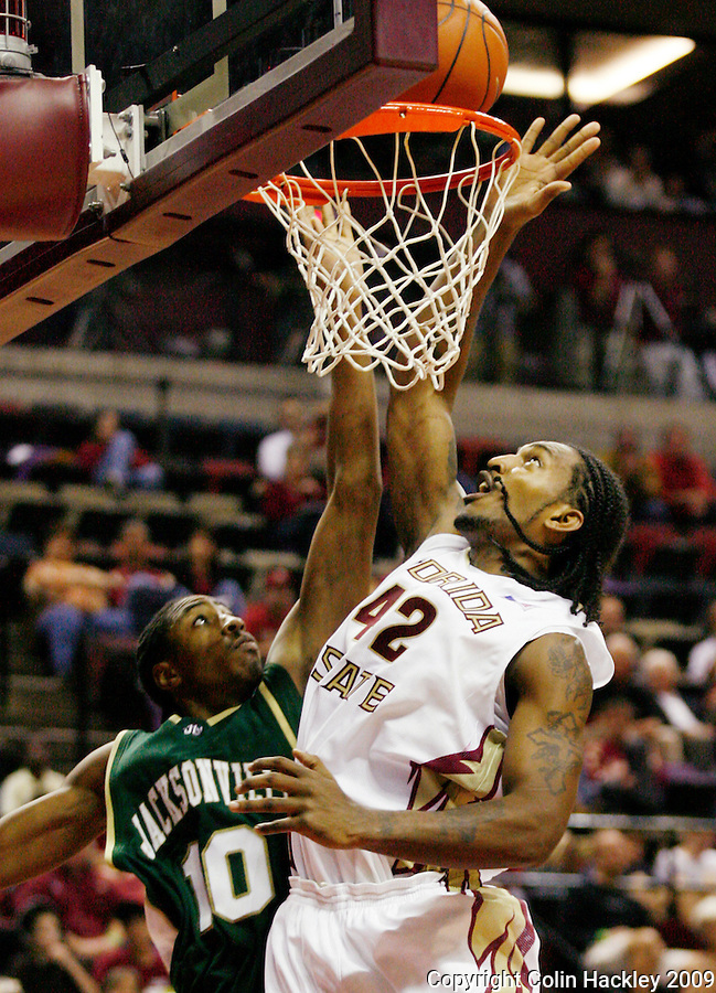 TALLAHASSEE, FL 11/16/09-FSU-JU BB09 CH15-Florida State's Ryan Reid battles with Jacksonville's Ayron Hardy for a rebound during second half action Monday at the Donald L. Tucker Center in Tallahassee. The Seminoles beat the Dolphins 87-61...COLIN HACKLEY PHOTO