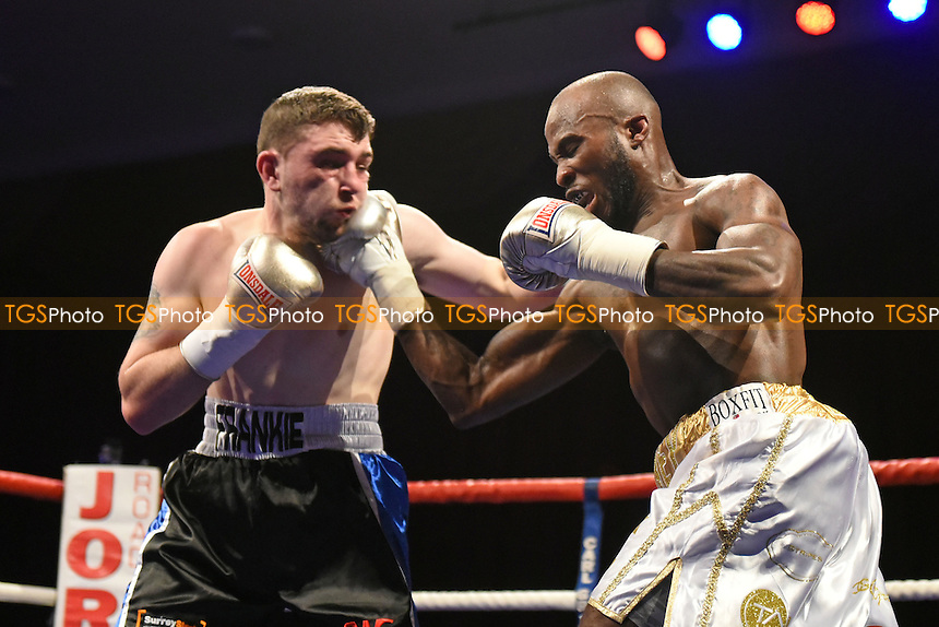 Danny Parsons (black/blue shorts) defeats Idris Hill during a Boxing Show at Grays Civic Hall on 23rd September 2016