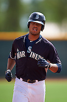 Seattle Mariners Gareth Morgan (12) runs the bases after hitting a home run during an instructional league game against the Texas Rangers on October 5, 2015 at the Surprise Stadium Training Complex in Surprise, Arizona.  (Mike Janes/Four Seam Images)
