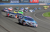 Oct. 10, 2009; Fontana, CA, USA; NASCAR Nationwide Series driver Joey Logano (20) leads the field during the Copart 300 at Auto Club Speedway. Mandatory Credit: Mark J. Rebilas-