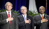 United States President George W. Bush, left, United States Secretary of Commerce Donald L. Evans, center, and United States Secretary of Education Doctor Rod Paige, right,  holds their hands over their heart during the presentation of the colors and the playing of the national anthem at the start of the presentation to the 2003 recipients of the Malcolm Baldrige National Quality Award.  A record 7 companies were honored with the national award in quality and preformance excellence.  The Baldrige National Quality Program (BNQP) is a public-private partnership to improve the performance of United States organizations.  It manages the annual award that is named for former United States Secretary of Commerce Malcolm Baldrige.  Secretary Baldrige served under United States President Ronald Reagan.<br /> Credit: Ron Sachs / CNP