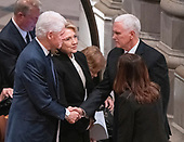 Former United States President Bill Clinton, left, shakes hands with US Vice President Mike Pence, left, as former US Secretary of State Hillary Rodham Clinton, center, looks on prior to the start of the National funeral service in honor of the late former United States President George H.W. Bush at the Washington National Cathedral in Washington, DC on Wednesday, December 5, 2018.<br /> Credit: Ron Sachs / CNP<br /> (RESTRICTION: NO New York or New Jersey Newspapers or newspapers within a 75 mile radius of New York City)