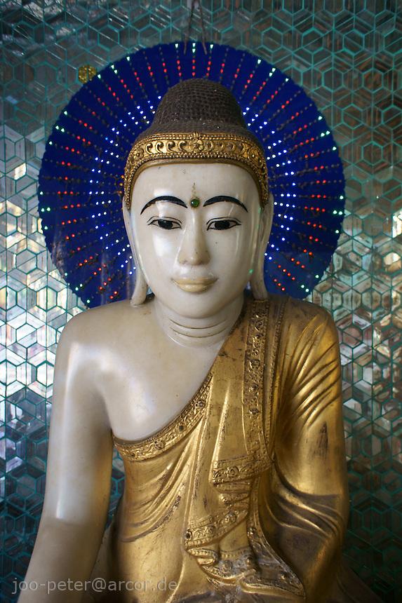 golden Buddha sculpture in a shrine of  Shwedagon pagoda complex, Yangon, Myanmar, 2011