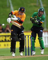 BJ Crook plays a defensive shot as Central keeper Bevan Griggs braces during the State Shield cricket match between the Wellington Firebirds and Central Stags at Allied Prime Basin Reserve, Wellington, New Zealand on Sunday, 11 January 2009. Photo: Dave Lintott / lintottphoto.co.nz