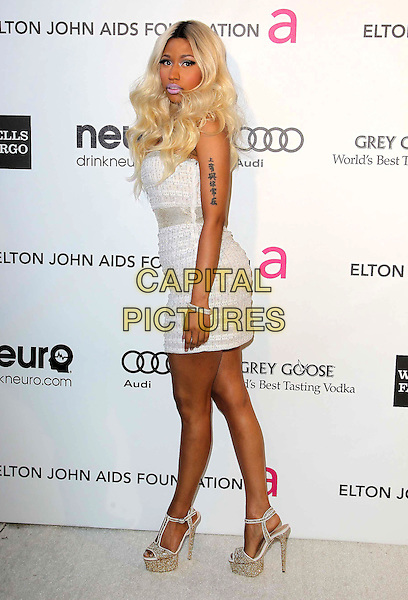Nicki Minaj.21st Annual Elton John Academy Awards Viewing Party held at West Hollywood Park, West Hollywood, California, USA..February 24th, 2013.oscars full length silver white strapless dress gold shoes platform side tattoo.CAP/ADM/KB.©Kevan Brooks/AdMedia/Capital Pictures.