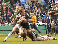 Reading, Berks, ENGLAND, 15.04.2006, Exiles Mike Catt, is held by Tykes half backs, Roland DeMarigny and Justin Marshall, Guinness Premiership, London Irish vs Leed Tykes, Madejski Stadium,  © Peter Spurrier/Intersport-images.com.