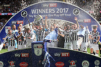 Millwall captain, Tony Craig, holds the Trophy aloft and celebrates after winning the Division One Play-Off Final during Bradford City vs Millwall, Sky Bet EFL League 1 Play-Off Final at Wembley Stadium on 20th May 2017