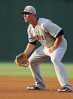 Infielder Andrew Clark (8) of the Hickory Crawdads, Class A affiliate of the Texas Rangers, in a game against the Greenville Drive on July 1, 2011, at Fluor Field at the West End in Greenville, South Carolina. (Tom Priddy/Four Seam Images)