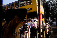 People board a double decker bus in central Mumbai, India. Photo by Suzanne Lee