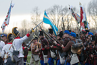 People in period military uniforms re-enact a historic battle in Tapiobicske (about 60 kilometres East-Southeast of capital city Budapest), Hungary on April 4, 2018. ATTILA VOLGYI