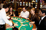 Blackjack table in Las Vegas, Nevada, Caesars Palace and Casino, gaming, gambling, chips, blackjack, betting croupier, blackjack players, model released, blackjack table, cards, NV, Las Vegas, Photo nv240-17425 ..Copyright: Lee Foster, www.fostertravel.com, 510-549-2202,lee@fostertravel.com