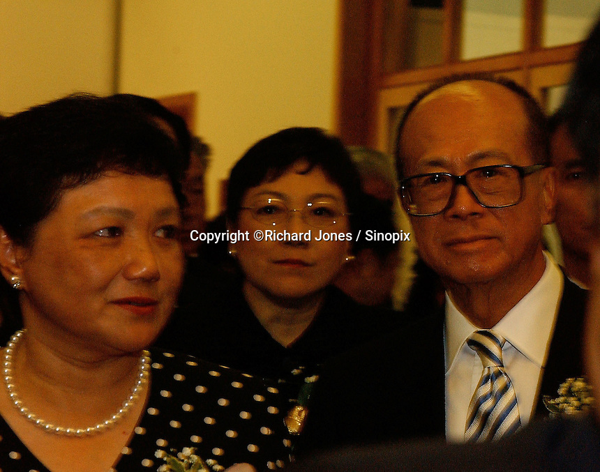 Li Ka Shing (right) together with Deng's daughters, Deng Nan (left) and Deng Rong (middle) at the opening ceremony of &quot;Giant of the Century&quot; - an exhibition to commemorate the 100th Anniversary of the Birth of Deng Xiaoping in Hong Kong. The exhibition aims at introducing Deng's life to the people of Hong Kong.<br /> 26-AUG-04