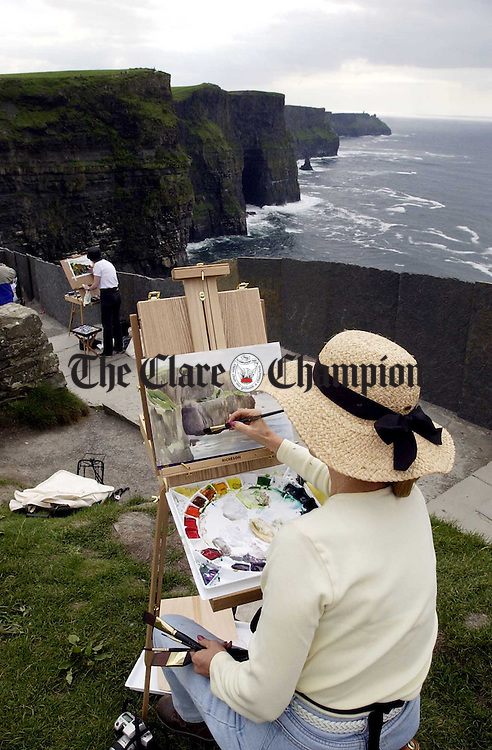 The view from above............<br /> American artists make the most of the fine spell as they paint at the Cliffs of Moher.  <br /> Photograph by John Kelly.