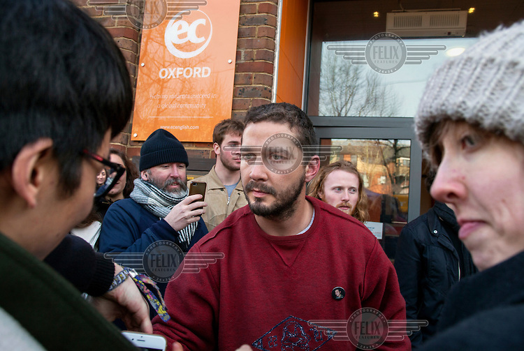 Looking a little worse for wear after spending 24 hours in a lift at EC Oxford, for a performance art project at an English language course centre in Gloucester Green, Shia LaBeouf meets students who have queued all night for the oportunity of a conversation with him.