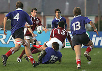 Georgia's Sandro Inashvili (red no.13) off-loads to colleague Rati Nutsubidze who scores his side's second try in the pool match of the Under 19 RWC at Malone, belfast 2007.