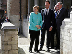 German Chancellor Angela Merkel and Dutch PM Mark Rutte (2nd L) pose for photographers upon arrival at the International Four Freedoms Award at the Nieuwe Kerk in Middelburg, The Netherlands, April 21, 2016. REUTERS/Michael Kooren