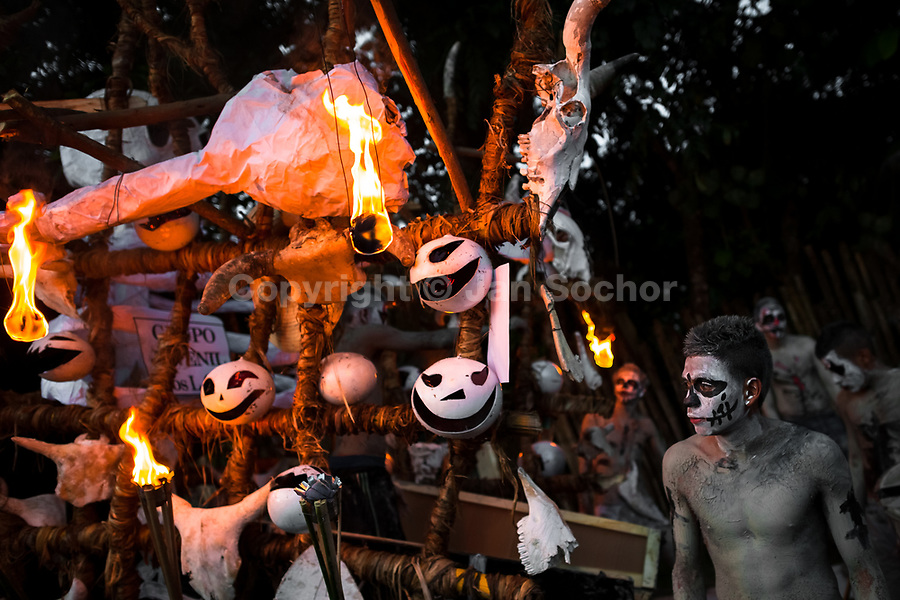 A young Salvadoran man performs along a mythological cart called La Carreta Chillona during the La Calabiuza parade at the Day of the Dead festivity in Tonacatepeque, El Salvador, 1 November 2016. The festival, known as La Calabiuza since the 90s of the last century, joins Salvador's pre-Hispanic heritage and the mythological figures (La Sihuanaba, El Cipitío, La Llorona etc.) collected from the whole Central American region, together with the catholic All Saints Day holiday and its tradition of honoring the dead relatives. Children and youths only, dressed up in scary costumes and carrying painted carts, march from the local cemetery to the downtown plaza where the party culminates with music, dance, drinking and eating pumpkin (Ayote) with honey.