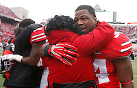 Ohio State Buckeyes running back Carlos Hyde (34) embraces family as nineteen seniors were recognized before Saturday's NCAA Division I football game against Indiana at Ohio Stadium in Columbus on November 23, 2013. (Barbara J. Perenic/The Columbus Dispatch)