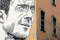 Roma 11-02-2014 Un enorme mural con il ritratto di Francesco Totti e' apparso ieri mattina sulla facciata della scuola Pascoli di Roma.<br /> An enormous mural of football player Francesco Totti appeared yesterday on the wall of a roman School.<br /> Photo Samantha Zucchi Insidefoto