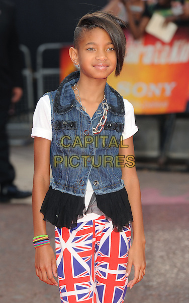 "WILLOW SMITH.The Gala Premiere of ""The Karate Kid"", Odeon Leicester Square, London, England, UK..15th July 2010.half length union jack trousers flag denim sleeveless jacket waistcoat white t-shirt frill black necklace.CAP/BEL.©Tom Belcher/Capital Pictures."