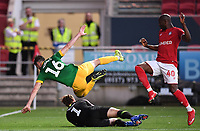 22nd July 2020; Ashton Gate Stadium, Bristol, England; English Football League Championship Football, Bristol City versus Preston North End; Declan Rudd of Preston North End takes the ball while Andrew Hughes of Preston North End and Benik Afobe of Bristol City dive over him