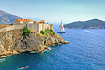 Sailing boat leaving Dubrovnik, Croatia.