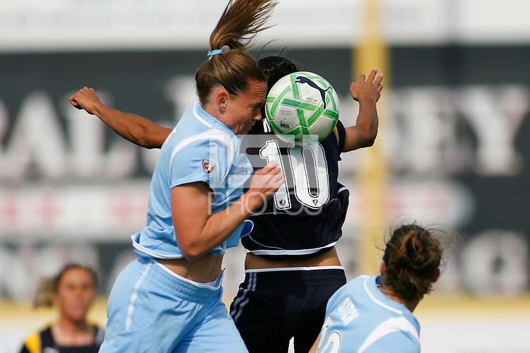 Christie Rampone (3) of Sky Blue FC battles Marta Vieira da Silva (10) of the Los Angeles Sol for a header during a Women's Professional Soccer match at TD Bank Ballpark in Bridgewater, NJ, on April 5, 2009. Photo by Howard C. Smith/isiphotos.com