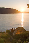 Couple, sea kayak camping, Strawberry Island, San Juan Islands, Puget Sound, Salish Sea, Washington State, U.S.A., Washington State Department of Natural Resources, Cypress Island Natural Resources Conservation Area,