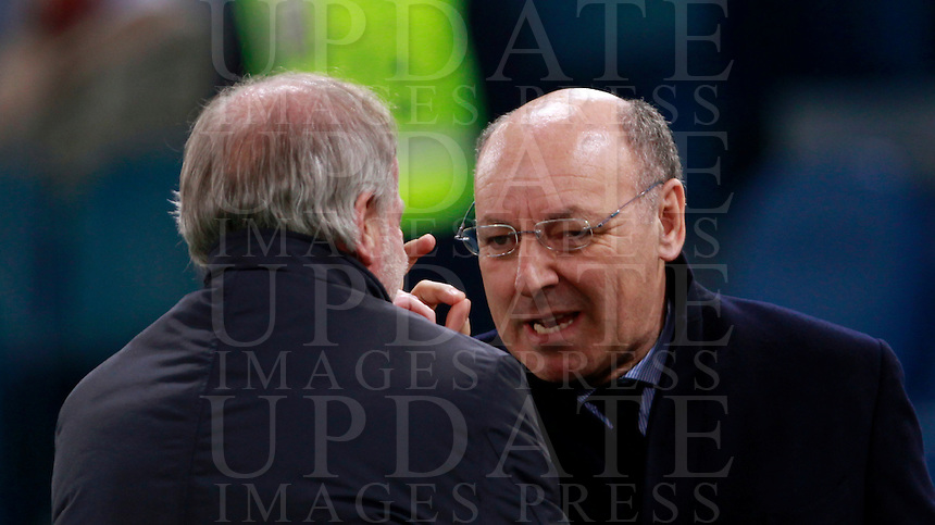 Calcio, quarti di finale di Coppa Italia: Roma vs Juventus. Roma, stadio Olimpico, 21 gennaio 2014.<br /> Juventus CEO Giuseppe Marotta, right, talks to AS Roma sporting director Walter Sabatini prior to the start of the Italian Cup round of eight final football match between AS Roma and Juventus, at Rome's Olympic stadium, 21 January 2014.<br /> UPDATE IMAGES PRESS/Isabella Bonotto