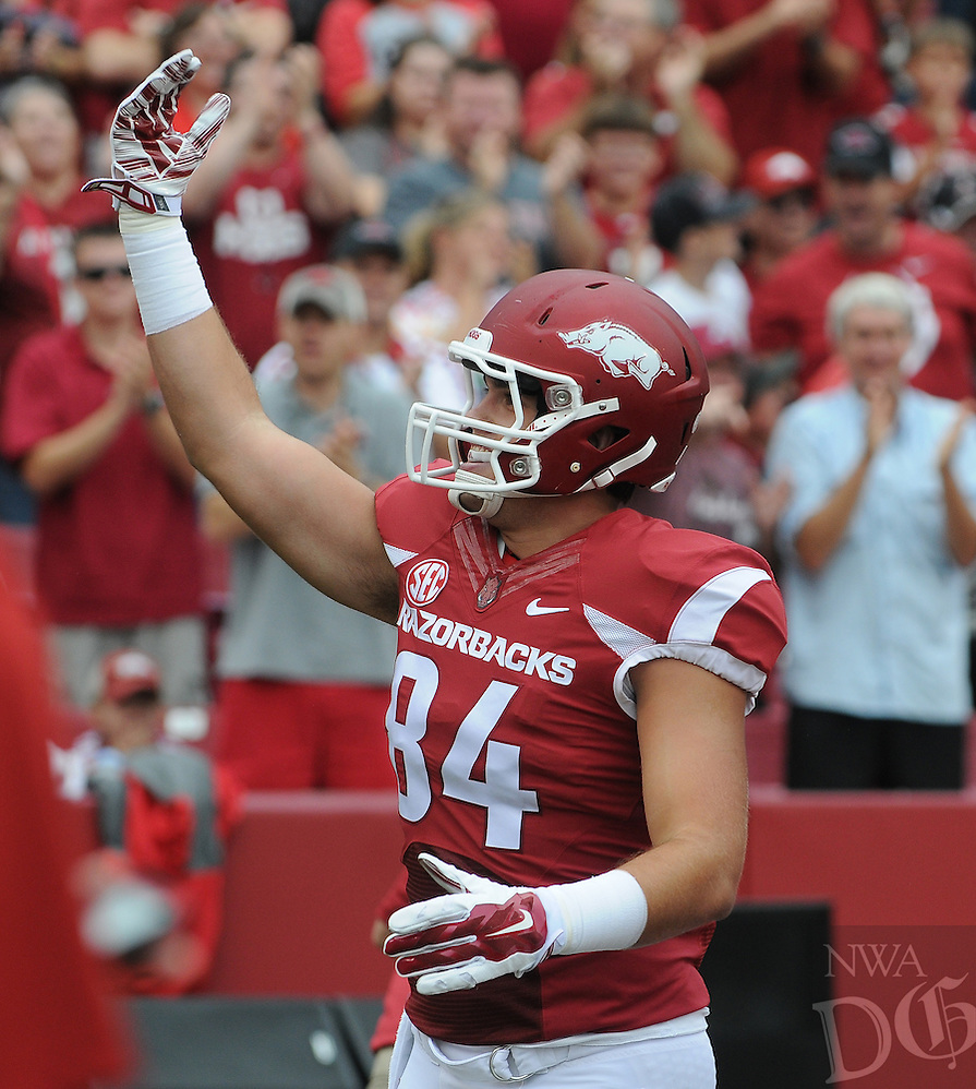 STAFF PHOTO ANTHONY REYES • @NWATONYR<br /> unter Henry Razorbacks tight end celebrates a touchdown against Nicholls State in the first quarter Saturday, Sept. 6, 2014 at Razorback Stadium in Fayetteville.