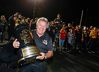 Nov 11, 2018; Pomona, CA, USA; NHRA photographer Richard Shute poses for a portrait with the championship trophy during the Auto Club Finals at Auto Club Raceway. Mandatory Credit: Mark J. Rebilas-USA TODAY Sports