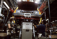 Detroit, U.S.A, December, 1980. End of the assembly line inside the Ford Rouge Factory. Ford Escort is the first compact car manufactured in the US.
