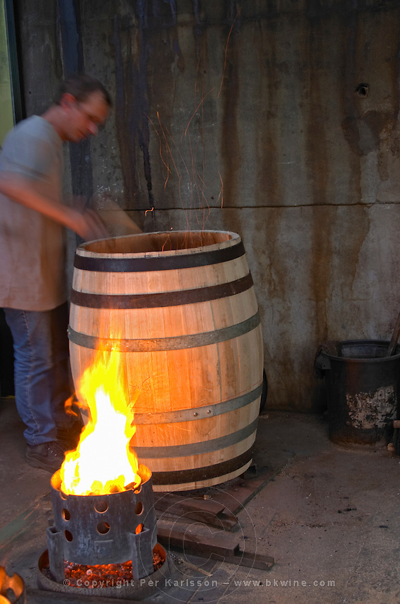 Toasting a barrel with fire on the inside tonnellerie gillet st romain cote de beaune burgundy france