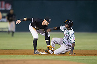 Frandy De La Rosa (28) of the Augusta GreenJackets is tagged out trying to steal second base by Max Dutto (6) of the Kannapolis Intimidators at Kannapolis Intimidators Stadium on May 3, 2017 in Kannapolis, North Carolina.  The Intimidators defeated the GreenJackets 7-4.  (Brian Westerholt/Four Seam Images)