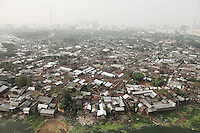 Slums of Dhaka. The capital of Bangladesh, is one of the world's biggest conurbation with an estimated population of more than 15 million people. It also bears the distinction of being the fastest-growing city in the world.