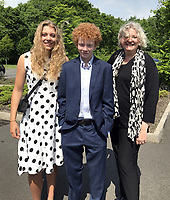 "Pictured L-R: Eve Stewart, Jake and Rachel Stewart, two of Pat Stewart's grandchildren and her daughter respectively.<br /> Re: The funeral of Pat Stewart at the Cardiff and Glamorgan Memorial Park and Crematorium, Wales, UK. Pat Stewart became famous as ""the girl in the spotty dress"" after an iconic image taken by Bert Hardy in Blackpool in 1951."