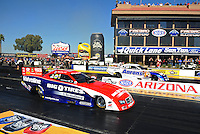 Feb. 17 2012; Chandler, AZ, USA; NHRA funny car driver Johnny Gray (near lane) races alongside Matt Hagan during qualifying for the Arizona Nationals at Firebird International Raceway. Mandatory Credit: Mark J. Rebilas-